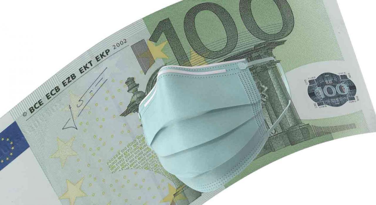 deducción, IRPF, IS, IRNR, donaciones, covid-19, coronavirus, Alava. Billete de 100 euros con una mascarilla