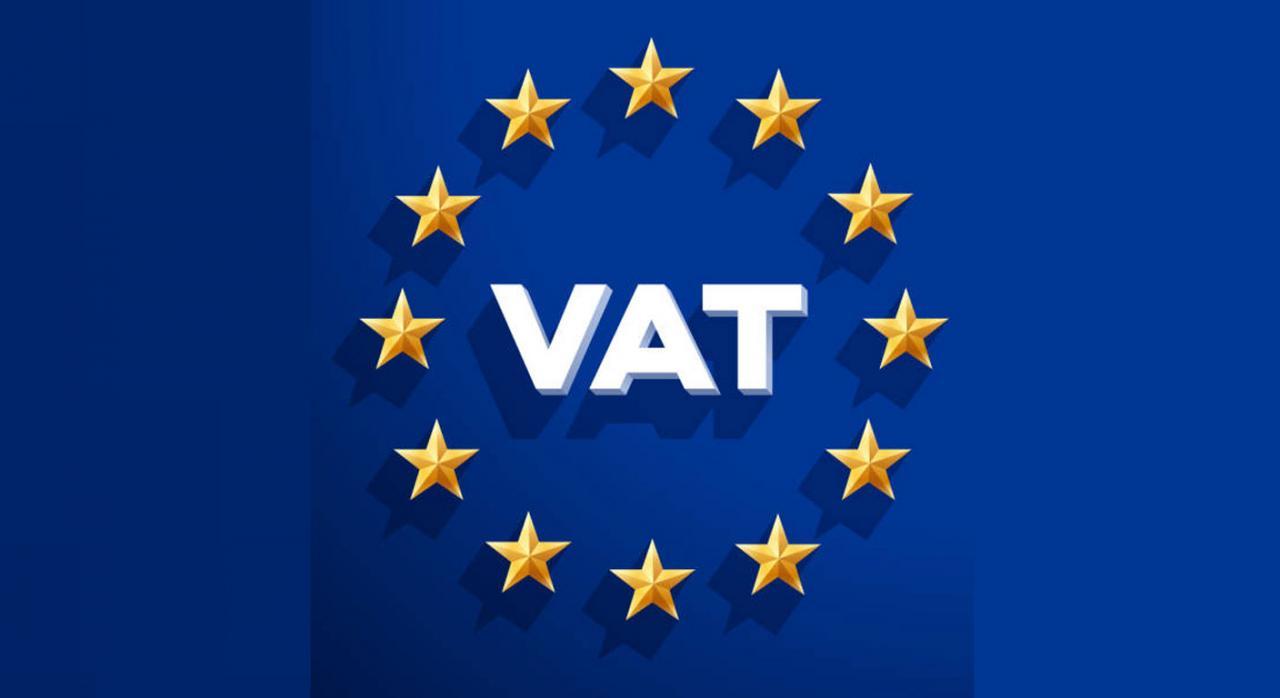 El ejercicio del derecho a deducir el IVA soportado sin ninguna limitación temporal sería contraria al principio de seguridad jurídica. Imagen de la palabra VAT escrita dentro de circunferencia de estrellas y sobre fondo azul
