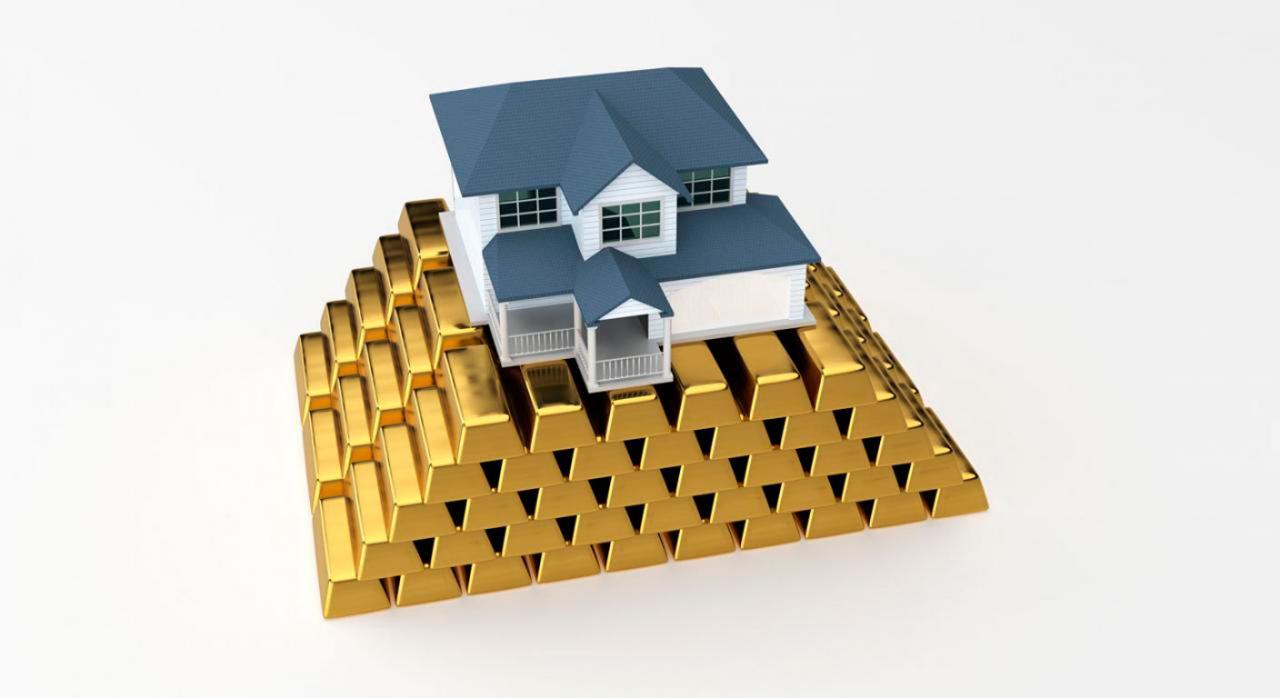 Empresas participadas por la SEPI. Imagen de una casa sobre lingotes de oro