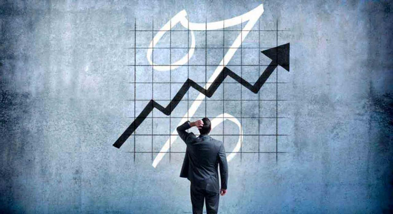 Interés efectivo anual. Hombre de negocios echándose la mano a la cabeza viento un gráfico ascendente
