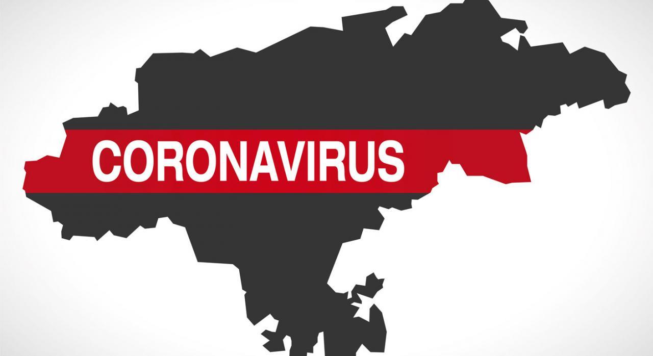 Medidas tributarias en Cantabria. Silueta de Cantabria con la palabra Coronavirus por encima