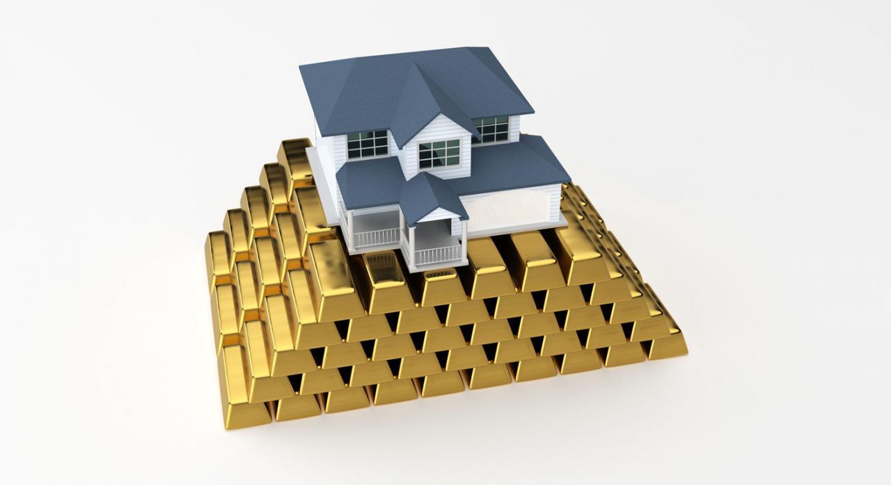 TS. Nulidad de pleno derecho de liquidaciones firmes de plusvalía (IIVTNU). Imagen de una casa sobre lingotes de oro