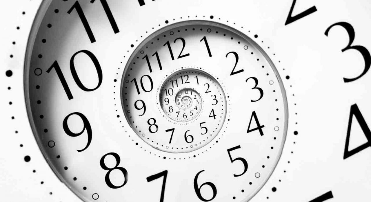 Plazos tributos en Cataluña. Reloj en forma de espiral infinita
