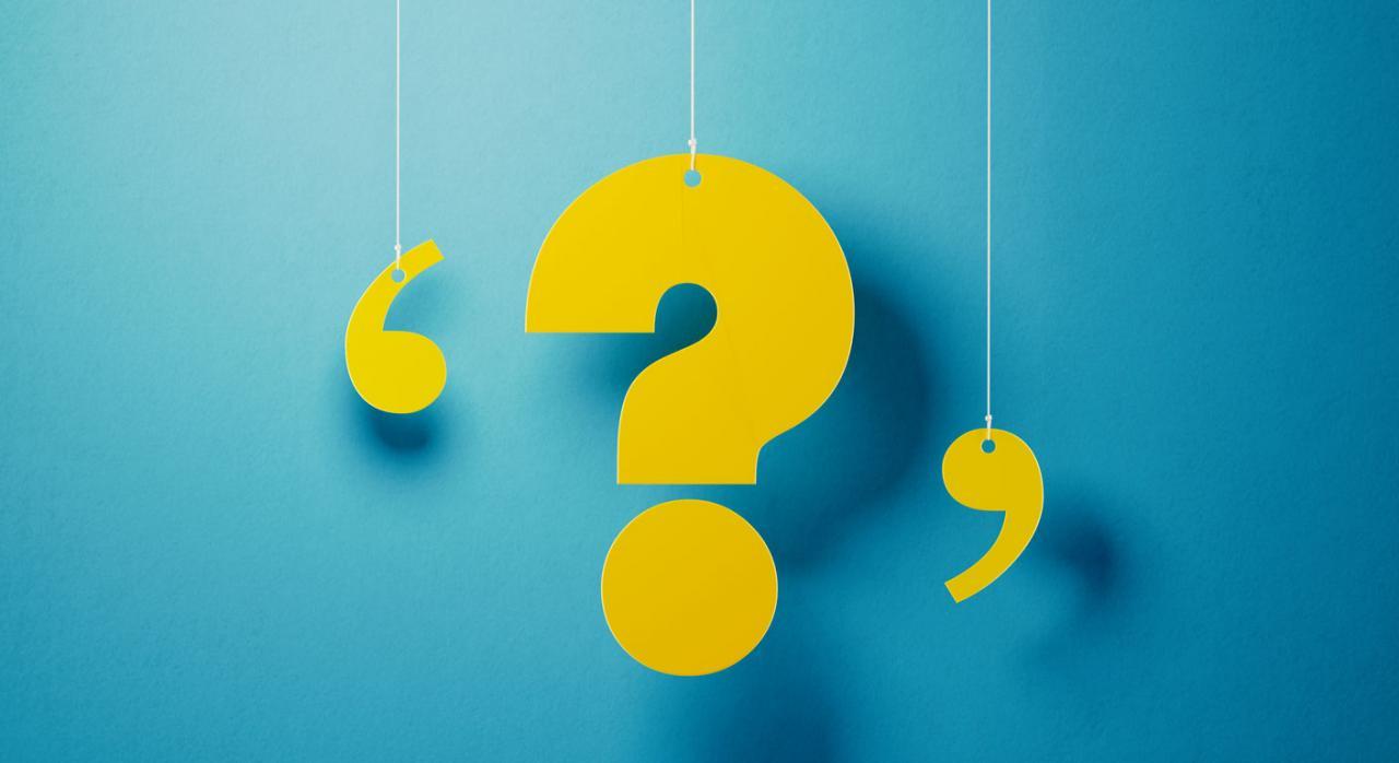 Preguntas frecuentes: plazo de declaración del IS. Signo de interrogación amarillo sobre fondo azul