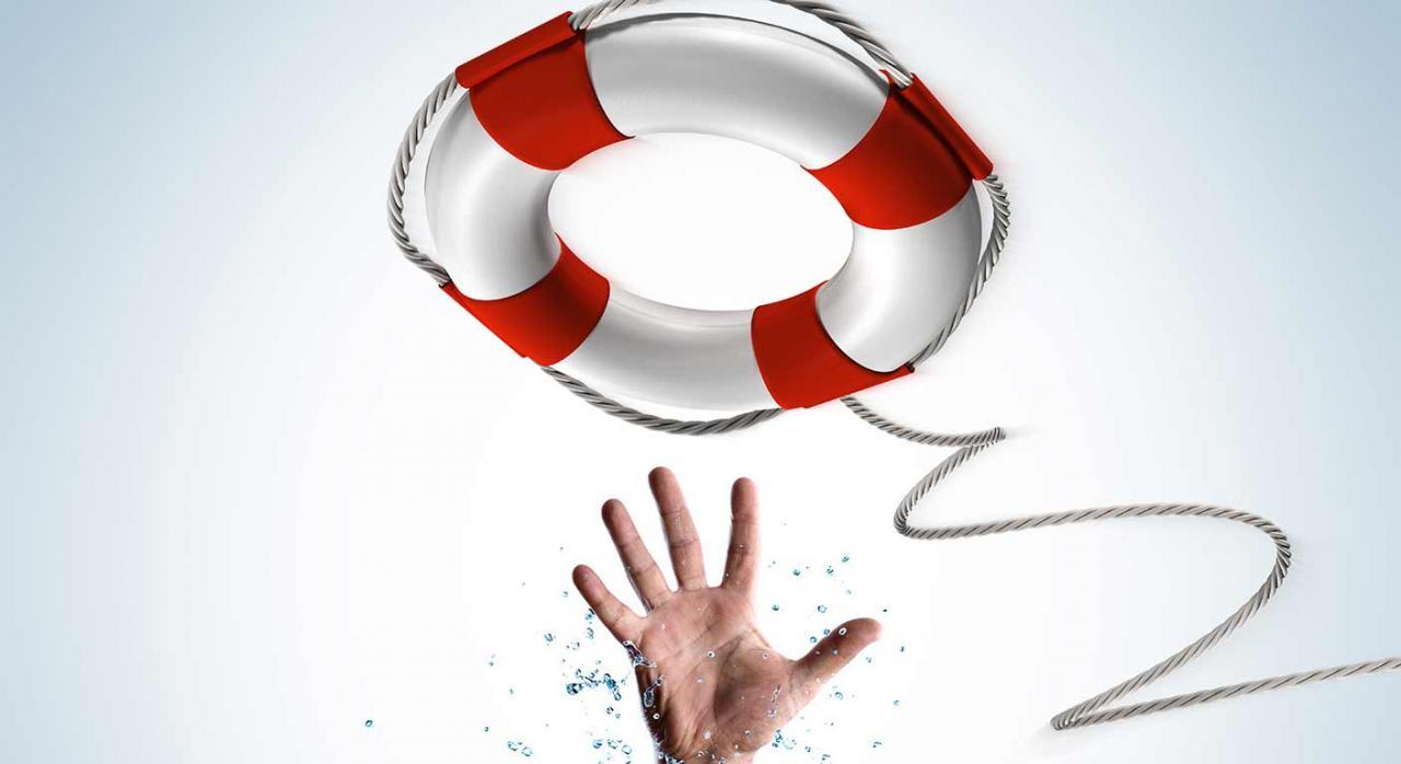 Subvenciones, ERE, imputación Imagen de una mano y un salvavidas