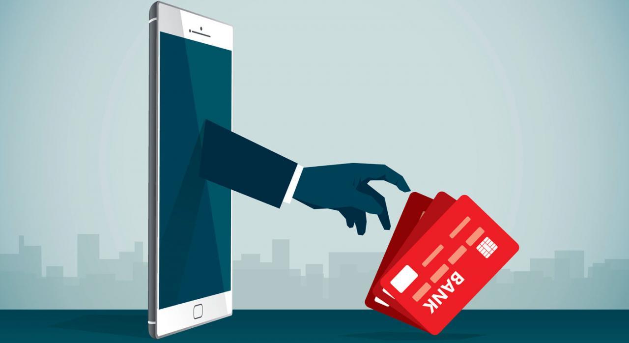 Teléfonos desde los que puede llamarte la Agencia Tributaria. Imagen de teléfono movil del cual sale una mano que coge tarjetas bancarias